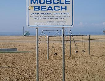 """""""Muscle Beach sign"""" by Charlie Brewer from Sydney, Australia - The old Muscle beach. Licensed under CC BY-SA 2.0 via Wikimedia Commons"""